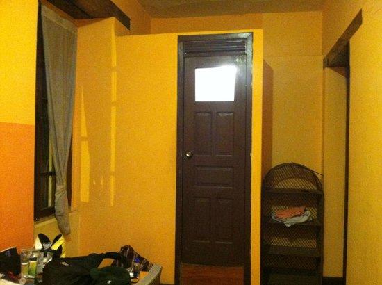 La Posada Colonial: View of door to mini bathroom inside room.