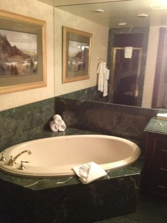 Suncoast Hotel and Casino: spa tube of bathroom in master suite.