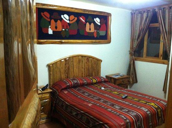 Hotel Santa Fe: Room with window overlooking interior in-hotel restaurant on level below.