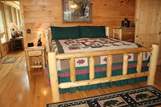 Brother's Cove Log Cabin Rentals: 1st-floor bedroom (king bed, private bath)