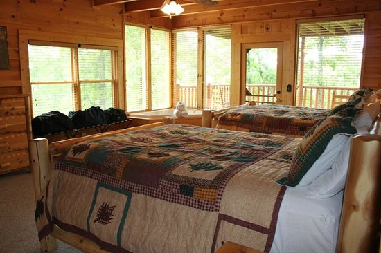 Brother's Cove Log Cabin Rentals: 2nd-floor bedroom (two queen beds, private bath & balcony)
