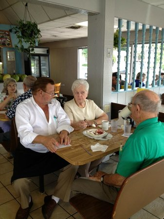 """Aunt Fannie's Restaurant: Owner """"Dwight"""" taking a moment with customers."""
