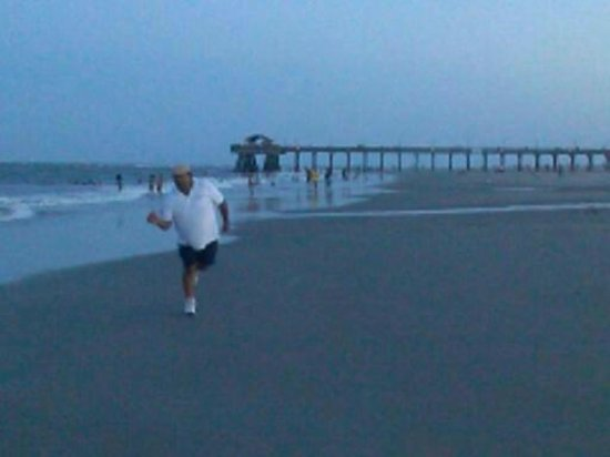 My hubby enjoying himself on the beach fishing pier at for Tybee island fishing pier