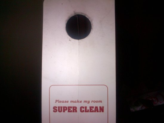 Super 8 Carlisle North: Hmmm...maybe they should clean the door hanger.?