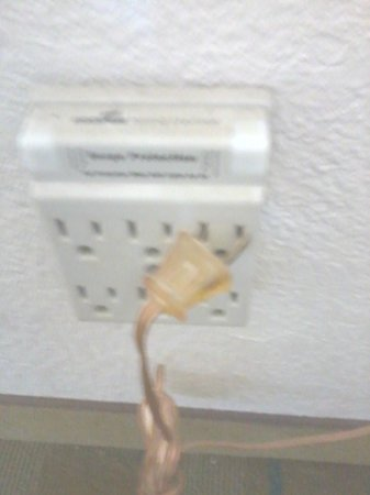 La Quinta Inn San Francisco Airport North: Light didn't work as plug was left in this manner