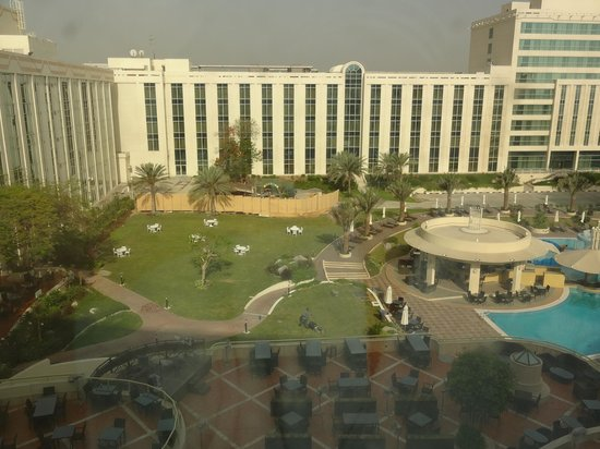 Millennium Airport Hotel Dubai: view from room looking over pool areas