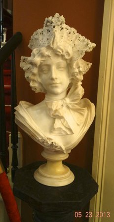 """Bocage Plantation: An alabaster sculpture where even the """"lace"""" hat is part of the alabaster."""