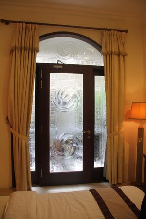 The Grand Palace Hotel Malang: the glass door leading to the balcony