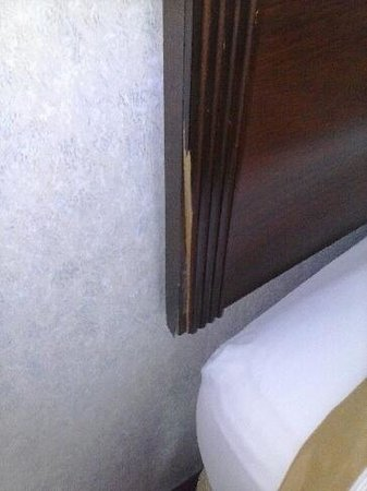 Ramada Bangor: All the woodwork on bedframes, nightstand , dresser and table were chipped and broken