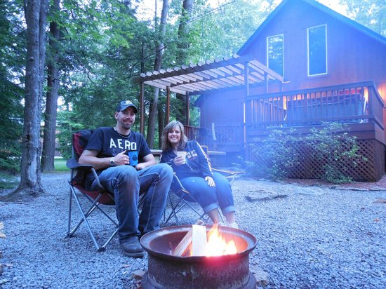 Campers Paradise: Us around our firepit, view of the deck & hot tub.
