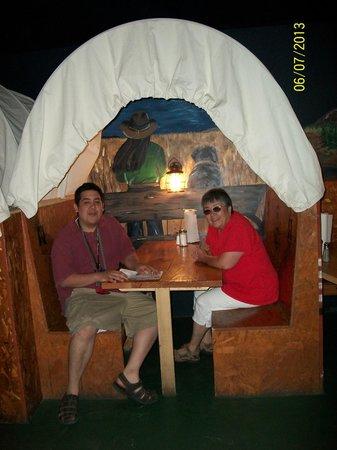 Buckaroo Bills: family eating at the covered wagon