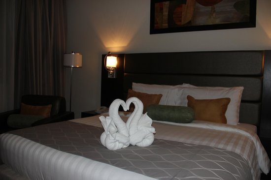 The Royal Riviera Hotel: welcome note fr the hotel to the guest ' Lovely Swan Decor on the bed '