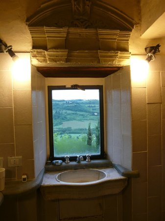 Castello di Bibbione: View out Bathroom window (note hand carved sink)
