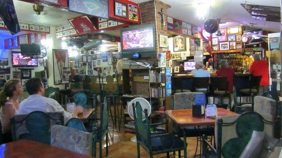 Stuff on the walls - Picture of Steve's Sports Bar & Grill