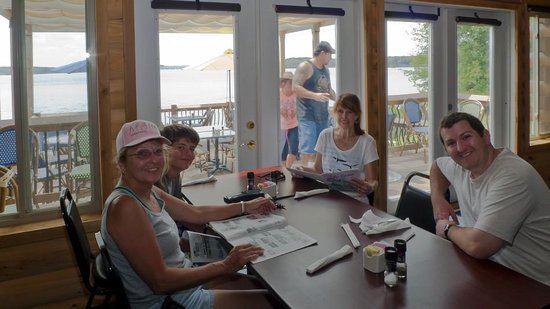 Watersview Restaurant: Sitting inside the air conditioned restaurant - nothing special as far as tables and chairs...ju