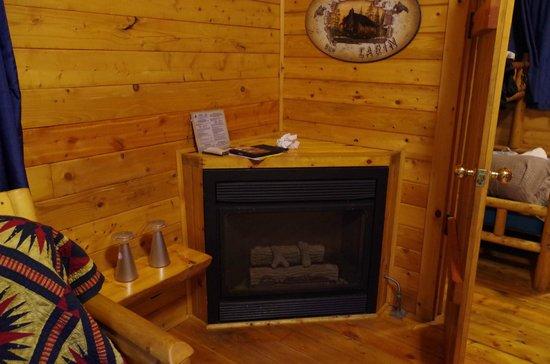 Gettysburg / Battlefield KOA: Fireplace in Living/Dining Room on Deluxe Cabin DK3