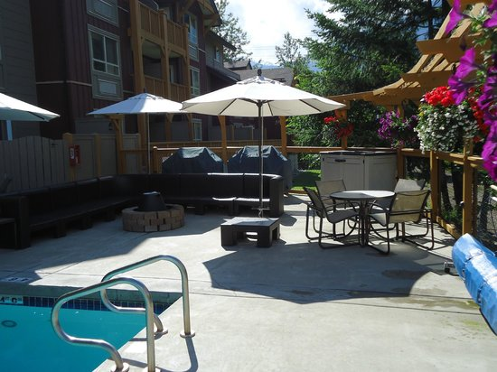 Pemberton Valley Lodge : Pool Area with Fire Pit and outdoor seating