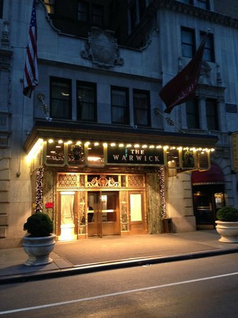 Warwick New York: 54th Street Entrance with Christmas decorations at night