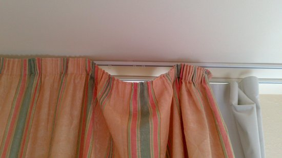 THB Ibiza Mar: Curtains hanging off the rail. Something that you get fined 200 euros for!!