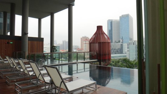 """PARKROYAL on Pickering: The pool """"pods"""" overlooking the city beyond."""
