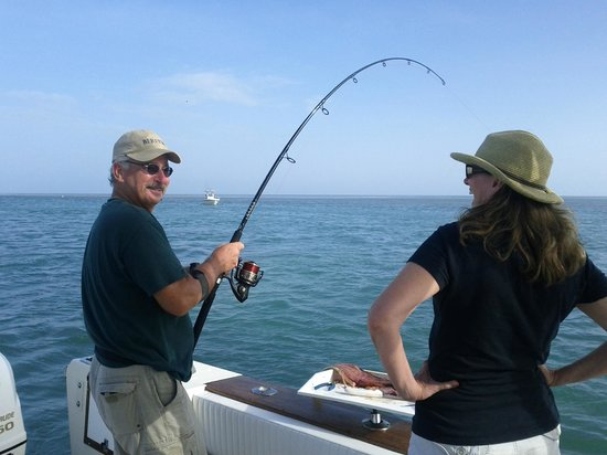 Fish on picture of neptune charters islamorada for Michigan fishing license prices
