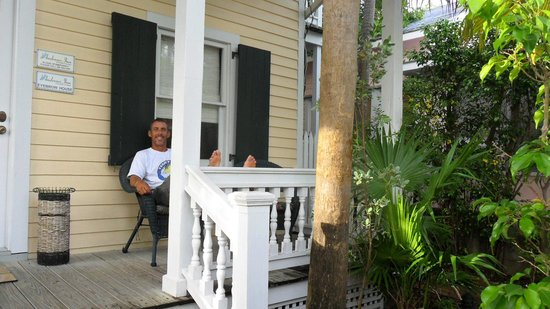 Andrews Inn and Garden Cottages: Hubby relaxing on Porch at the Eyebrow House Andrews Inn Cottage
