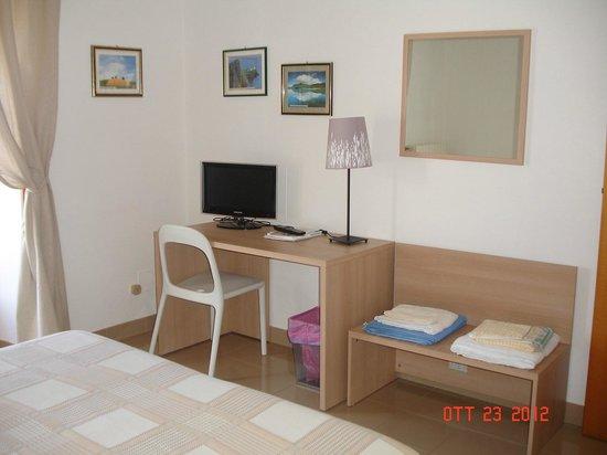 Casa Miraglia: Camera magnolia angolo TV