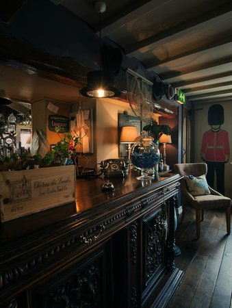 The Rose and Crown: Side Bar (our doorman Henry can be seen, guarding the Door!)