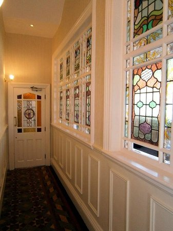 The Royal Hotel: Beautiful stained-glass windows in the corridor to the reception area.