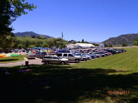 Lava Hot Springs KOA: The parking lot of swimming pool from the grassy hill where we played frisby