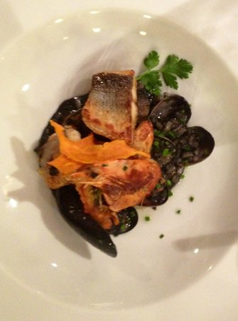 MON RESTAURANT: three fish on black ink risotto with mussels
