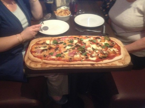 The Stables Restaurant: The giant meter long pizza