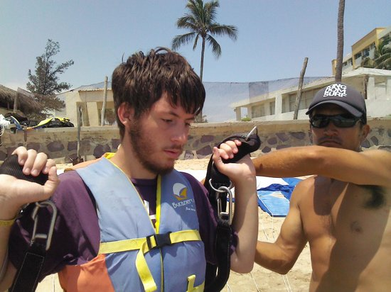 Aqua Sports Center and Scuba Dive: getting strapped into the harnass