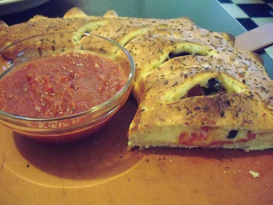 Route 16 Diner & Pizzeria: the Calzone -to give an idea of the size,  that bowl is about 4""