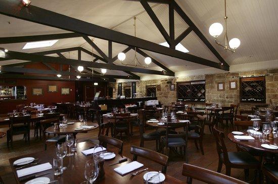 Kingsleys Australian Steakhouse: Rustic, warm, inviting dining space