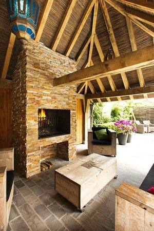 Charming Brugge: fire place by the pool