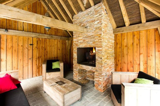 Charming Brugge: covered terrace with fireplace