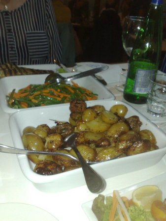Paulus Kitchen : Side helpings of roasted potatoes and veg.