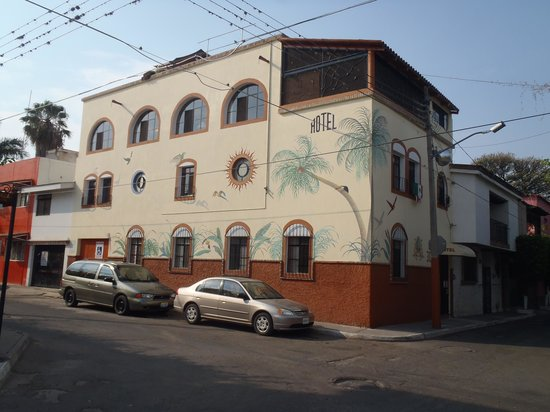 El Pequeno Suites: Side view on Calle Ninos Heroes
