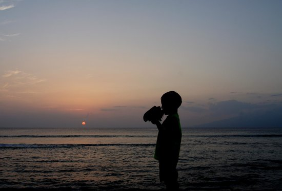 Nohonani Condos: My 4 year old blowing the conch at sunset