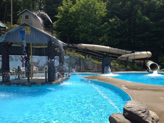 Smugglers' Notch Resort: waterslide that leads to 6 foot pool at notchville park