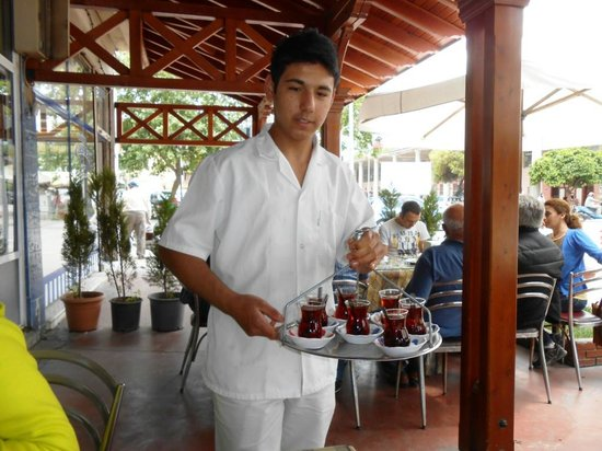 Okumuslar Pide Salonu: The young waiter with cay