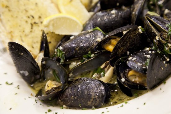 Deck House: Sauteed Mussels in white wine, basil and garlic. Most folks say ours are the best they've had!