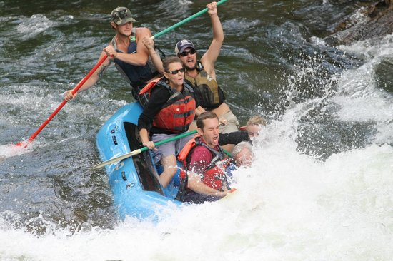 Appalachian Rivers Raft Company: Whew! Glad I didn't sit next to my son - he's crashing into his dad!