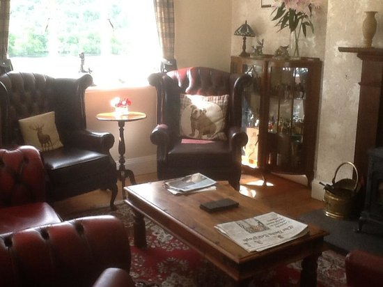Glenurquhart House Hotel : Photo is part of a very large lounge with comfortable chesterfield chairs and sofas.