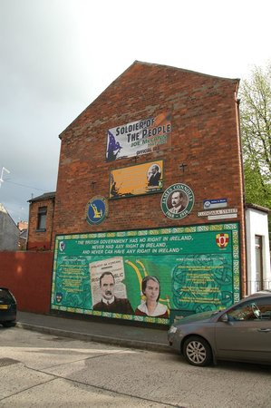 A mural depicting the origin myth of the red hand of for Belfast mural tours