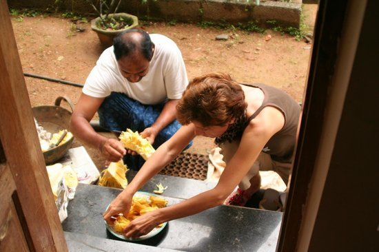 Rose Gardens Homestay: removing the nuts from the jackfruit to use later