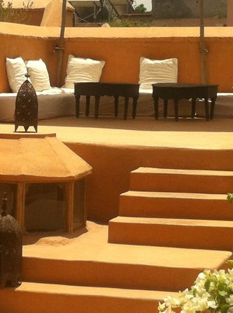Hotel & Spa Dar Baraka & Karam : seating area on the roof top, be careful with the walls, the colour can transfer onto clothes