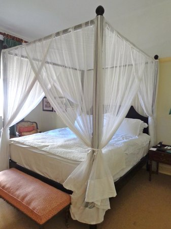 The Victoria Falls Hotel: four-poster bed with mosquito netting