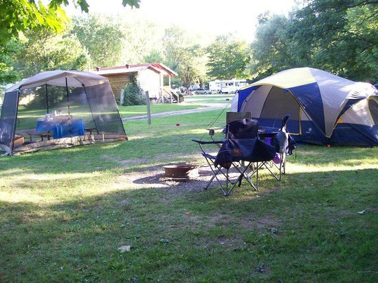 Yogi Bear's Jellystone Park : Rustic Water Only Campsite with Shower/Restrooms in background